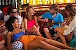 Friends enjoying guitar playing in bar