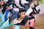Group of teenagers dancing in studio