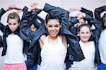 Group of teenagers dancing hip hop in studio