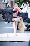 Girl breakdancing in carpark