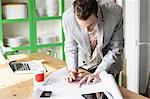 Man bending over work documents