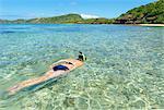 Woman snorkelling, Yasawa island group, Fiji, South Pacific islands