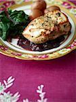Stuffed turkey breast with vegetables on elegant plate, studio shot