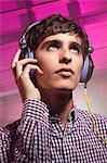 Teeange boy wearing headphones, portrait