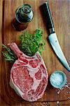 Ribeye steak with salt and fresh herbs