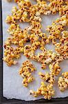Caramelised popcorn on a baking tray