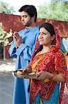 Rural couple praying, Sohna, Haryana, India