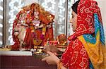 Woman praying in a temple, Sohna, Haryana, India