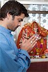 Farmer praying in a temple, Sohna, Haryana, India