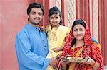 Rural family praying in a temple, Sohna, Haryana, India