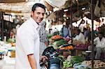 Man standing in a vegetables market, Sohna, Gurgaon, Haryana, India