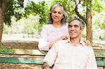 Portrait of a mature couple smiling, Lodi Gardens, New Delhi, India