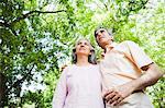 Mature couple standing in a park, Lodi Gardens, New Delhi, India