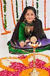 Girl making rangoli on Diwali