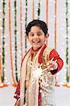Boy burning fire crackers on Diwali
