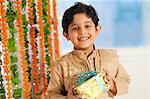 Boy holding a gift on Diwali