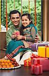Man and his daughter celebrating Diwali