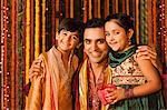 Man hugging his children on Diwali