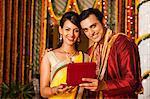 Man gifting jewelry to his wife on Diwali