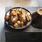 Pigeon and confit kumquat Tajine