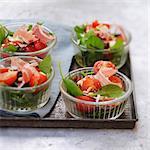 Individual tomato,corn lettuce and smoked ham salads