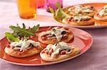 Mushroom and diced ham mini pizzas