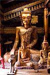 Ancient gilded wooden Buddhas inside Wat In, Kengtung (Kyaingtong), Shan State, Myanmar (Burma), Asia
