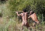 San (Bushmen) demonstrating traditional hunting technique with bow and arrow at the Okahandja Cultural Village, near Okahandja town, Namibia