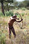 San (Bushman) demonstrating traditional hunting technique with bow and arrow at the Okahandja Cultural Village, near Okahandja town, Namibia