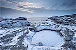 Snow dusted Kes Tor showing Dartmoor's largest rock basin, Dartmoor National Park, Devon, England, United Kingdom, Europe