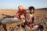 Local Bedouins prepare traditional Arab bread, Marsa Alam desert, Egypt, North Africa, Africa