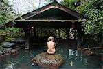 Woman enjoying the hot waters of the Kurokawa onsen, public spa, Kyushu, Japan, Asia