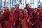 Monks in procession during Full Moon Festival, Patho Ananda temple, Bagan (Pagan), Myanmar (Burma), Asia