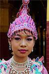 Young Burmese girl during ritual for becoming a nun, Paya Mahamuni, Mandalay, Myanmar (Burma), Asia