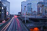 Evening traffic flowing through the La Defense area of Paris, France, Europe