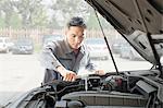 Garage Mechanic Working on Engine