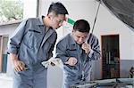 Mechanic Listening to Engine
