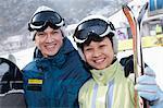Smiling Couple in Ski Resort