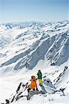 Two skiers taking a look at mountain range, European Alps, Tyrol, Austria