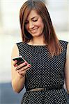 Business woman using smartphone, Zagreb, Croatia, Europe