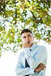 Portrait of Businessman Thinking Outdoors, Mannheim, Baden-Wurttemberg, Germany