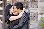 Couple Kissing by Log Cabin, Toronto, Ontario, Canada