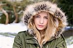 Teenage Girl Wearing Hooded Parka Outdoors