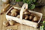 Raw potatoes in basket