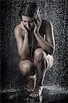 Woman kneeling in shower