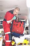 Paramedics in ambulance checking equipment