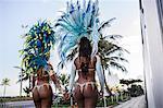 Rear view of samba dancers holding hands, Ipanema Beach, Rio De Janeiro, Brazil