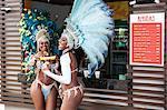 Samba dancers having hot dogs, Rio De Janeiro, Brazil