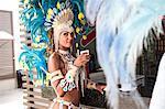 Samba dancer with refreshment, Rio De Janeiro, Brazil