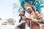 Samba dancers using cellphone, Rio De Janeiro, Brazil